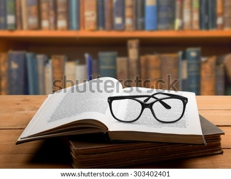 Book and glasses, background, studying.