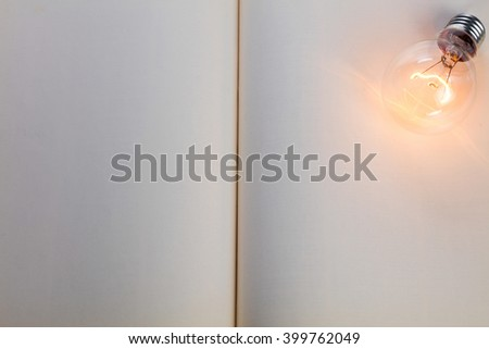 book and light bulb, business education concept. - stock photo