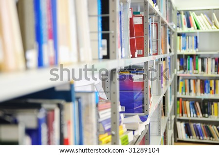 book and magazines in modern library at university - stock photo
