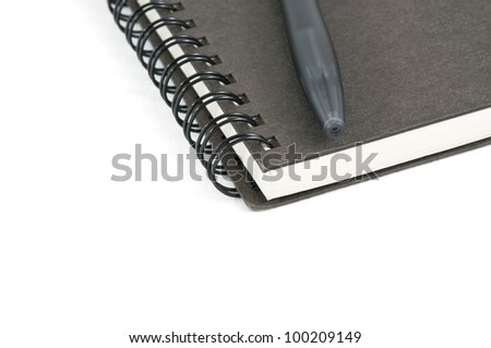 Book and pen on white  isolated background - stock photo