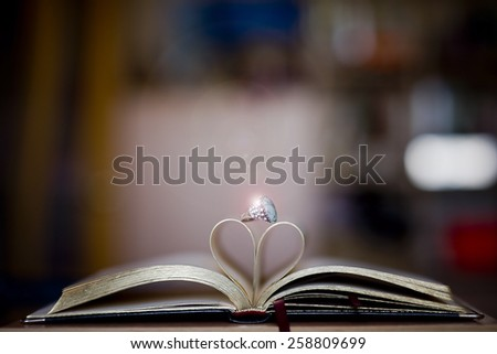 book and ring - stock photo