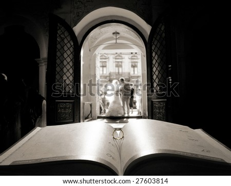 Book and ring over church door background - stock photo