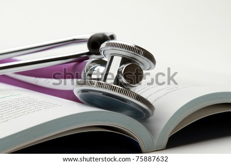 book and stethoscope isolated on white background - stock photo