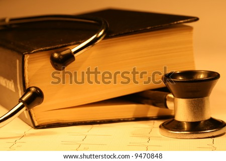 Book and stethoscope on a EKG printout