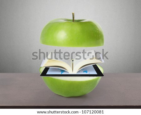 Book and tablet computer  model and green  apple - stock photo