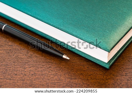 Book and the pen - stock photo