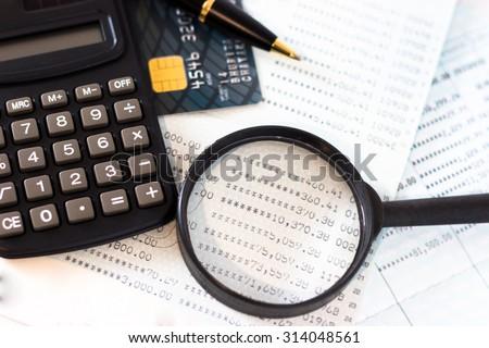 Book bank, credit cards, the calculator, a ball pen. - stock photo