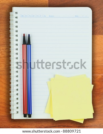 Book, Colorful pen and Post it on Parquet background - stock photo