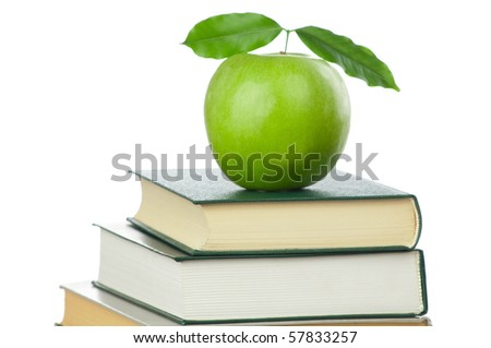 Book heap and green apple isolated on white background - stock photo