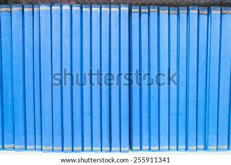 Book in a bookshelf standing out at university library. - stock photo