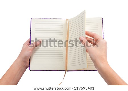 Book in hands isolated on white background
