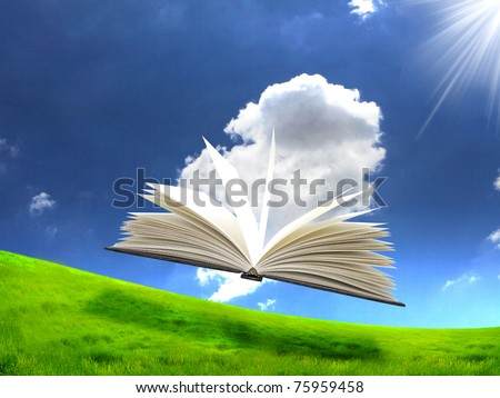 book in the air against green panoramic nature landscape