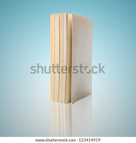 book isolated on blue background - stock photo