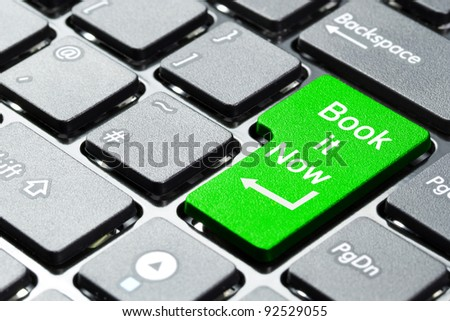 Book it now button on computer keyboard - stock photo