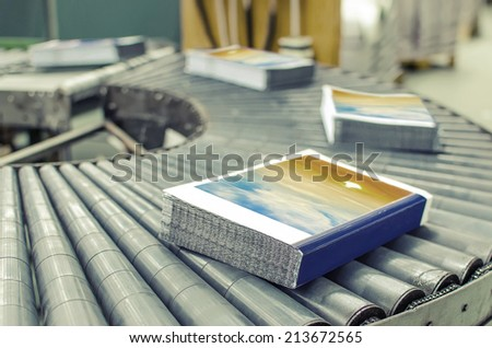 Book, magazine,  production line into press plant house. Automatic assembly line. VINTAGE - stock photo