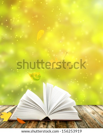 Book of nature on autumn background - stock photo