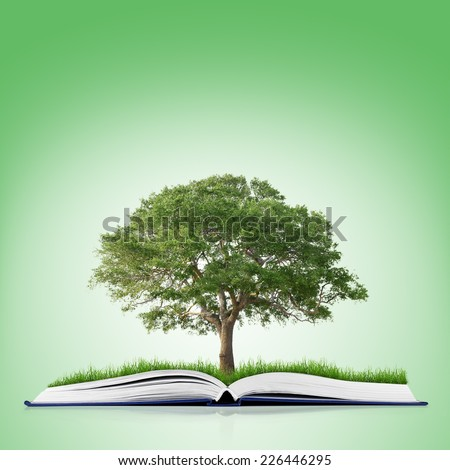 book of nature with grass and tree growth on it over white green background - stock photo