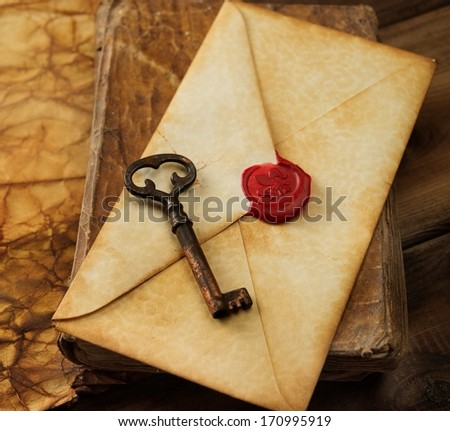 Book, old key and envelope on vintage blank paper - stock photo