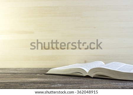 Book on a wooden table. Book is a dictionary. Toned - stock photo