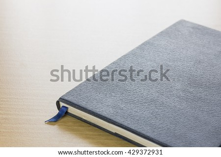Book on deck wood background - stock photo