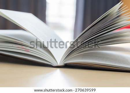 book on the desk in library
