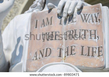 Book on the Jesus sculpture with the sentence from John 14:6 part. - stock photo