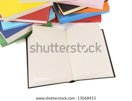 Book : open blank book laying amongst a collection of colorful books isolated on a white background.  Space for copy. - stock photo