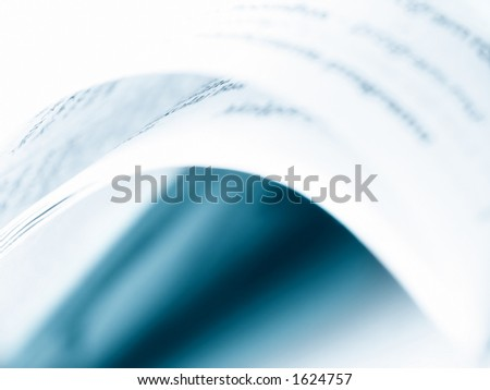 Book opened. Blue toning. Abstract. Soft focus. - stock photo