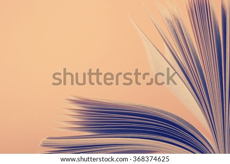 Book pages macro view. Toned image. Copy space for text - stock photo
