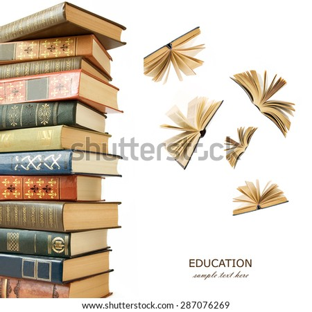 Book pile and open books flying away isolated on white background with sample text - stock photo