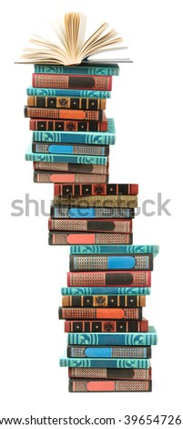 Book pile with open book in top isolated on white background - stock photo