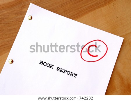 Book Report  C on Desk - stock photo