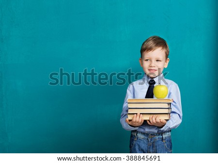 Book, school, kid. little student holding books. Cheerful smiling little kid against chalkboard. Looking at camera. School concept. Back to School - stock photo