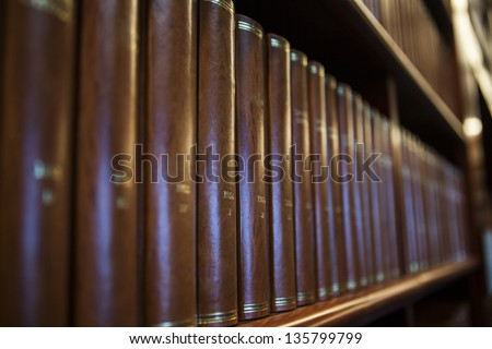 Book shelf in a church library full with brown books - stock photo