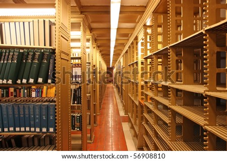 Book shelves in a public library - stock photo