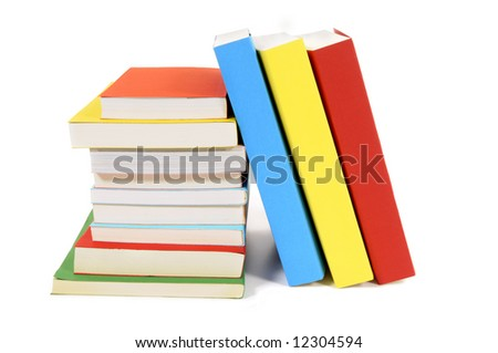 Book stack : collection of colorful paperback books isolated on white background.