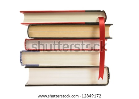 Book stack : small stack of hardback books with bookmark ribbon isolated on white background.