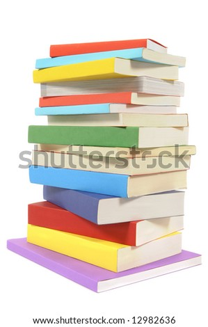 Book stack : untidy pile of colorful paperback books isolated on white background.  Vertical format.
