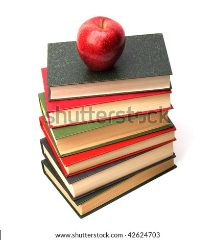 book stack with apple isolated on white background