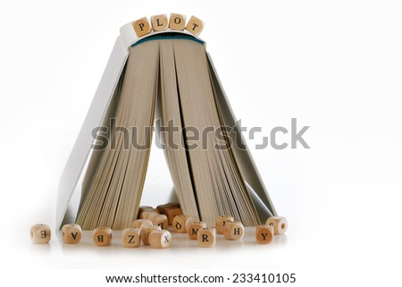 "book standing frontal like a house, message ""plot"" on the top, several letters for creative story writing at the bottom, isolated on white background - stock photo"