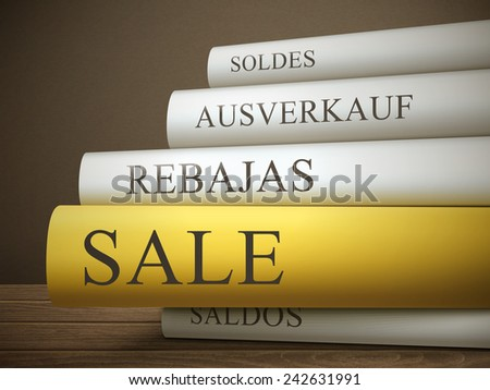 book title of sale isolated on a wooden table over dark background - stock photo