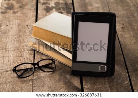 Book vs ebook - stock photo
