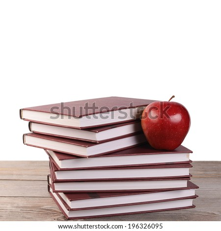 Book with apple isolated on white  background