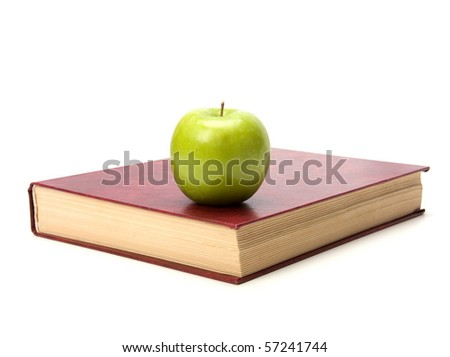 book with apple isolated on white background - stock photo