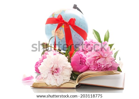 book with blooming peonies and globe on white background - stock photo