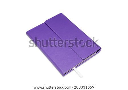 Book with book mark made of leather purple. - stock photo