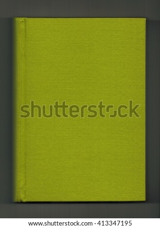 Book with green cloth cover over dark grey background