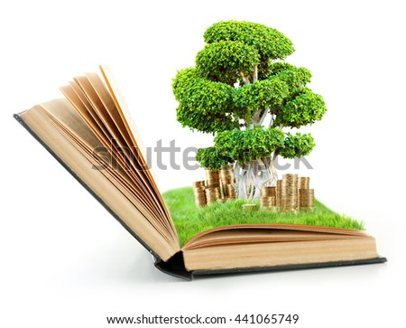 Book with green tree in bag and coins isolated on white - stock photo