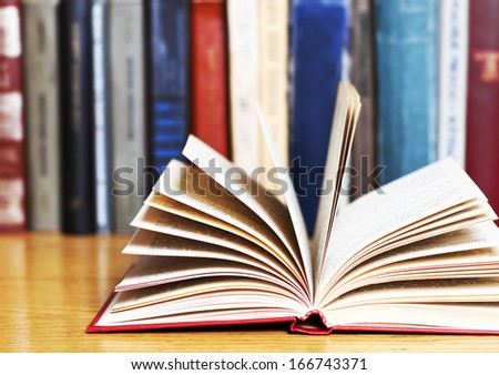 book with library on the back  - stock photo