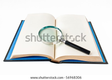 Book with magnifying glass on white background - stock photo